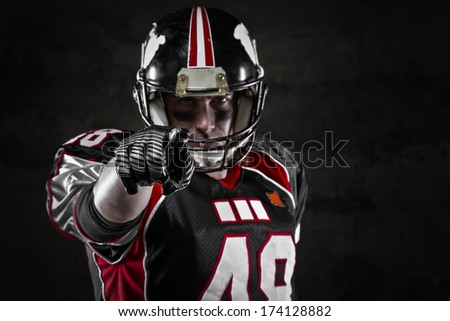 Portrait of american football player pointing at you  - stock photo