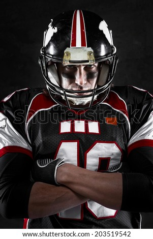 Portrait of american football player with intense gaze - stock photo