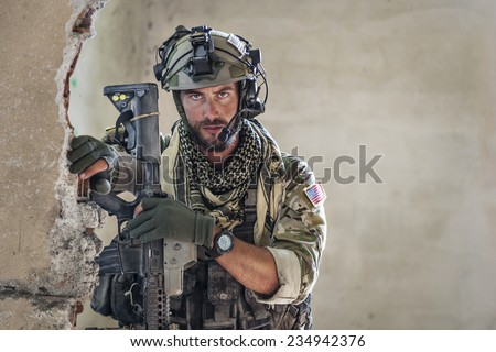 Portrait of American Soldier resting and looking at camera - stock photo