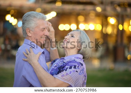 Portrait of amusing senior couple on vacation - stock photo