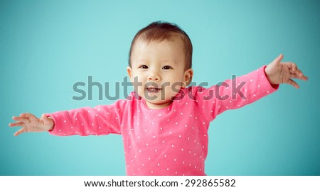 Portrait of an adorable baby girl - stock photo