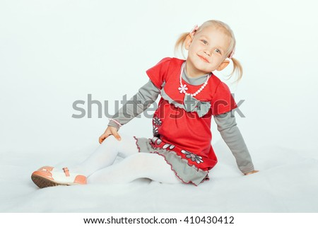 Portrait of an adorable baby girl blonde. Girl smiling - stock photo