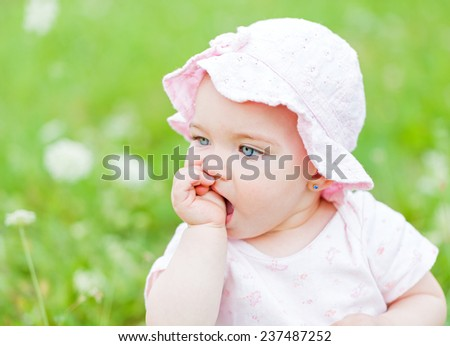 Portrait of an adorable baby girl in outside - stock photo