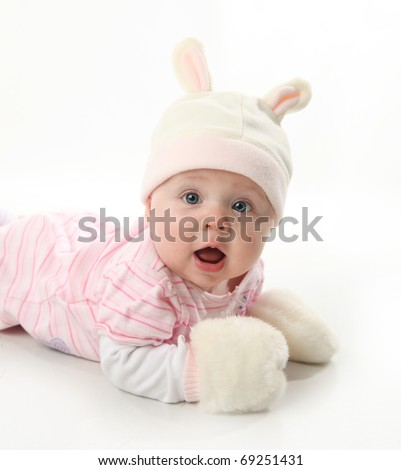 Portrait of an adorable baby girl wearing a bunny rabbit costume - stock photo