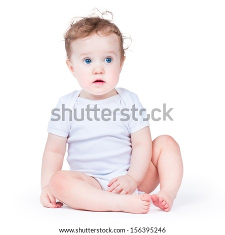 Portrait of an adorable baby girl with beautiful blue eyes, on white background