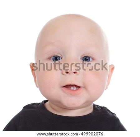 Portrait of an adorable child with the first teeth in a black shirt on a white background