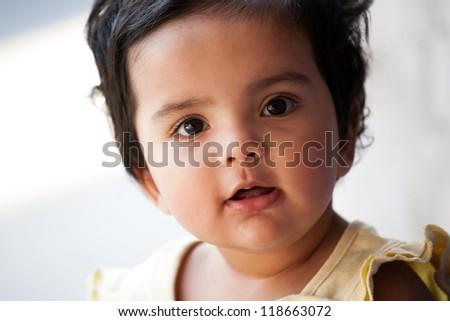 Portrait of an adorable cute little baby girl. - stock photo