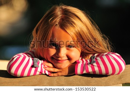 portrait of an adorable happy five year old girl - stock photo