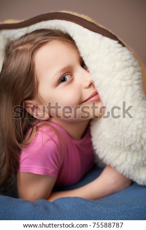 Portrait of an adorable little girl in bed