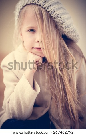 Portrait of an adorable preschool age girl in fashionable clothes - stock photo