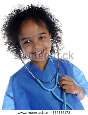 "Portrait of an adorable preschool ""doctor"" in scrubs happily listening to her own heart through a stethoscope.  On a white background. - stock photo"
