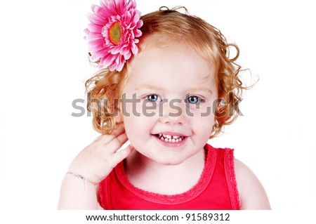 portrait of an adorable red haired girl with flower in her hair isolated