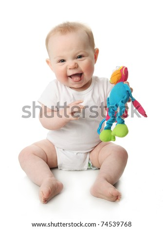 Portrait of an adorable smiling baby playing with a monkey rattle toy, isolated on white - stock photo