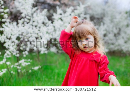 Portrait of an adorable young girl, flowering gardens