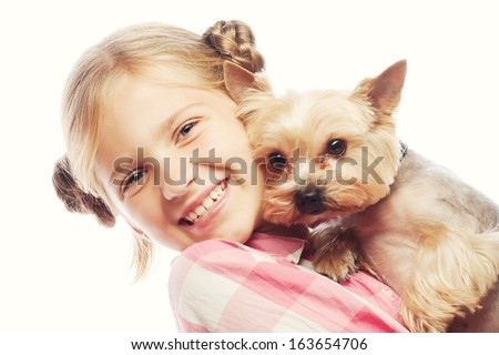 Portrait of an adorable young girl smiling holding Yorkshire Terrier puppy