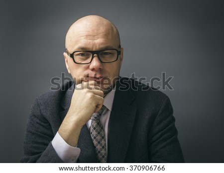 Portrait of an adult man in a business suit  - stock photo