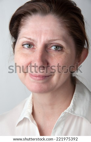 Portrait of an adult woman in a white blouse. Closeup. - stock photo