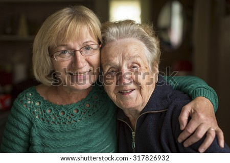 Portrait of an adult woman with his elderly mother. - stock photo