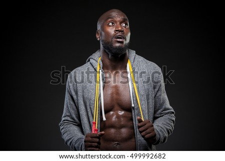 portrait of an African American athlete with jump rope around his neck.