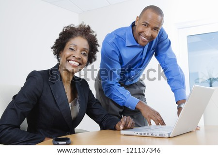 Portrait of an African American business people working together in office - stock photo
