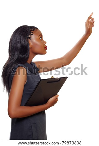 Portrait of an African American business woman pointing up while holding a folder during presentation on white background
