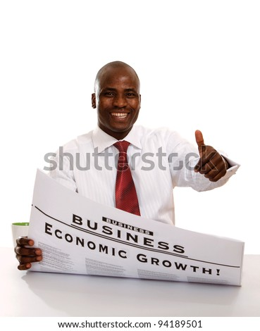 Portrait of an African American businessman reading a newspaper and showing ok, isolated on white background