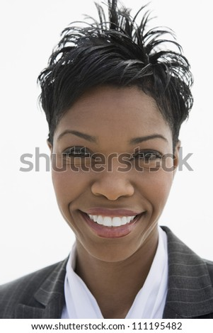 Portrait of an African American businesswoman isolated over white background - stock photo
