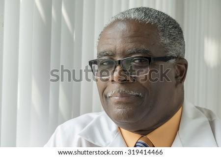 Portrait of an African American Doctor, in glasses, close up - stock photo