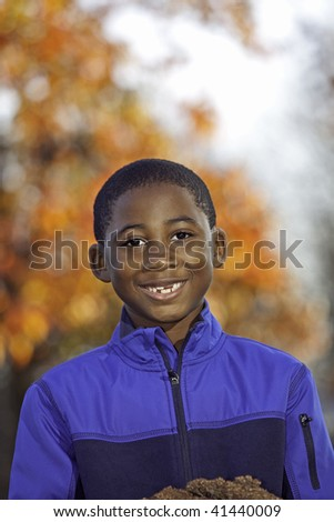 Portrait of an African American male child outdoors in Autumn - stock photo