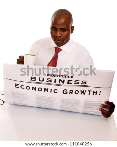 Portrait of an African American with cup of tea or coffee and newspaper