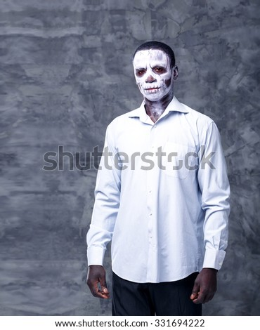 Portrait of an african man in the image of a skeleton or zombie. Festival, carnival, party, Halloween male african zombies. African people. Voodoo people. - stock photo