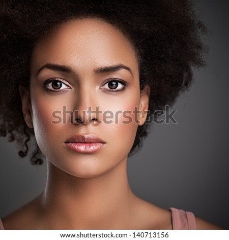 Portrait of an African woman with a serious expression on her face. - stock photo