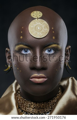 Portrait of an African woman with traditional national pattern on head with blue eyes