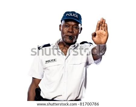 Portrait of an afro American police officer making a stop gesture in studio on white isolated background - stock photo