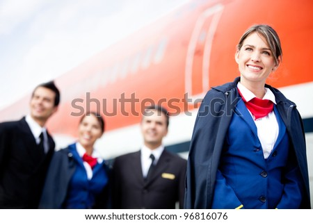 Portrait of an airplane cabin crew smiling - stock photo