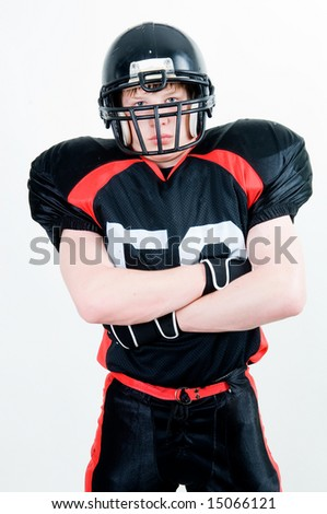 Portrait of an American football player isolated on white background - stock photo