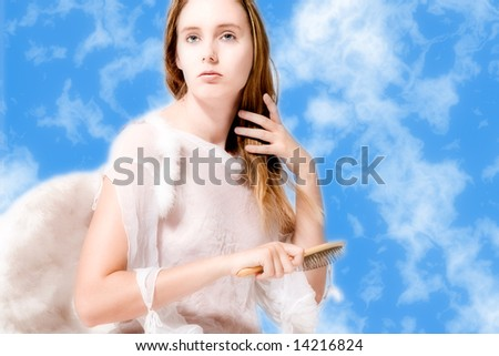 Portrait of an angel in the clouds who is brushing her hair