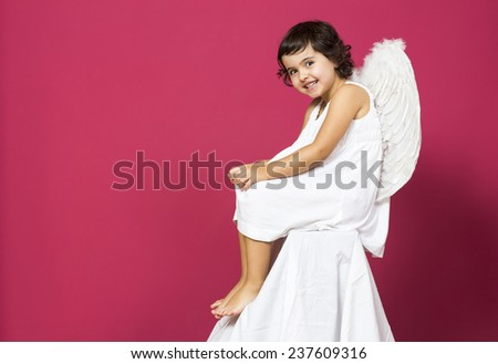 Portrait of an angel little girl - stock photo