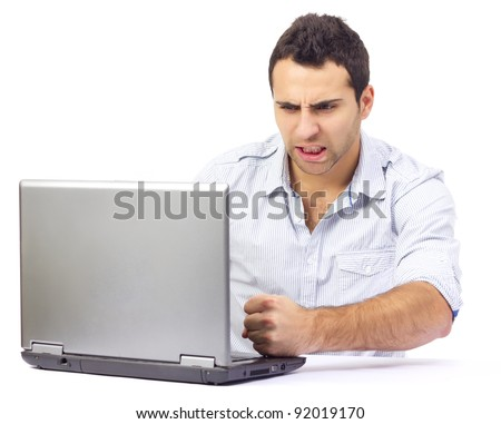 Portrait of an angry business man at his laptop, on white background - stock photo