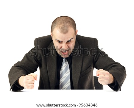 Portrait of an angry business man.Mad expression on his face and clenched fists.White background. - stock photo
