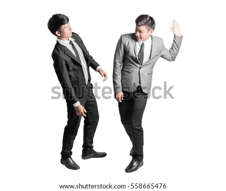 Portrait of an angry businessman is slapping across the businessman's face. Isolated full body on white background