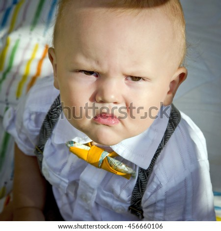 Portrait of an angry little boy. Selective soft focus - stock photo