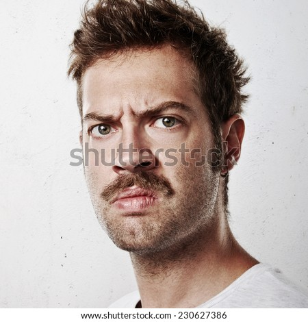 Portrait of an angry man - stock photo