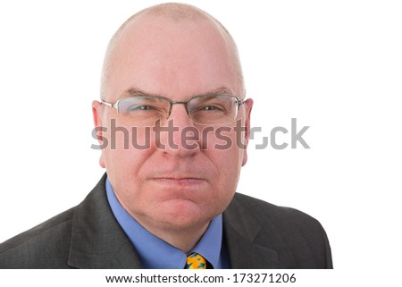 Portrait of an angry revengeful Caucasian middle-aged bald businessman wearing glasses and formal business suit looking at camera with a malicious facial expression, isolated on white background