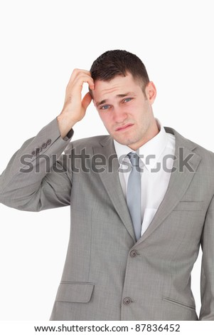 Portrait of an anxious businessman against a white background - stock photo