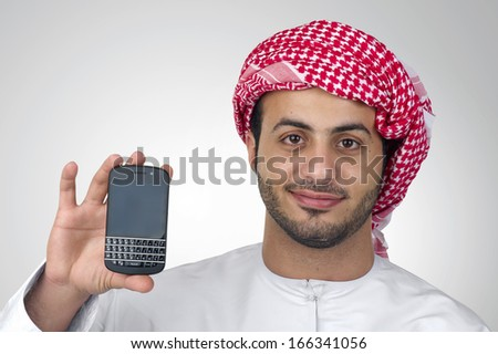 Portrait of an Arabian business man holding a phone for presentation isolated - stock photo