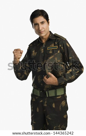 Portrait of an army soldier clenching his fist