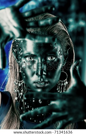 Portrait of an artistic woman painted with black color and spangled. Body painting project. Jewellery. - stock photo