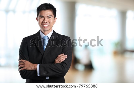 Portrait of an Asian Businessman with background out of focus