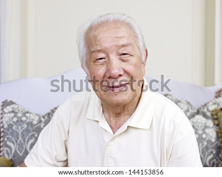 portrait of an asian senior man. - stock photo